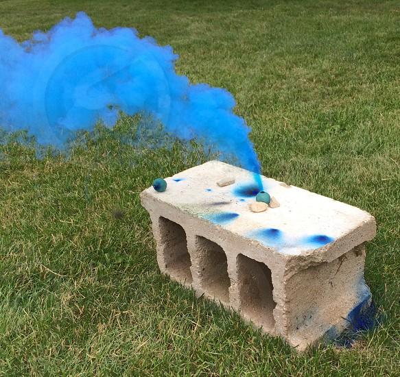 Blue smokesmoke bombgrassconcrete block photo