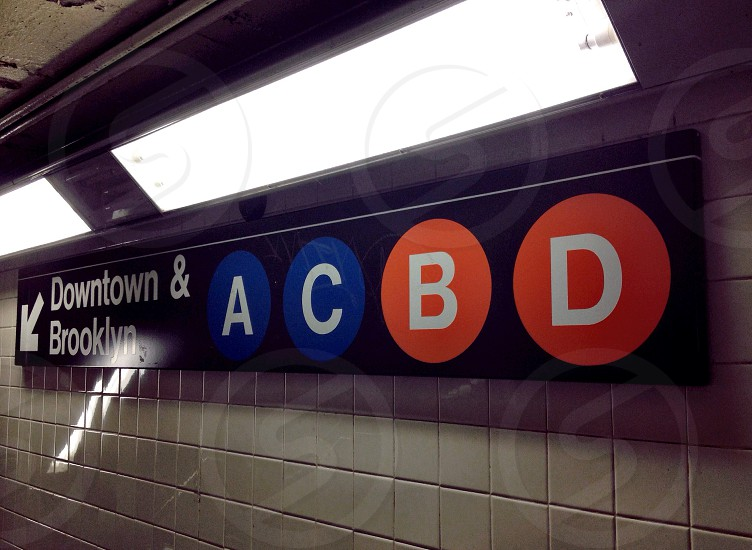 view of downtown &  brooklyn train signage photo
