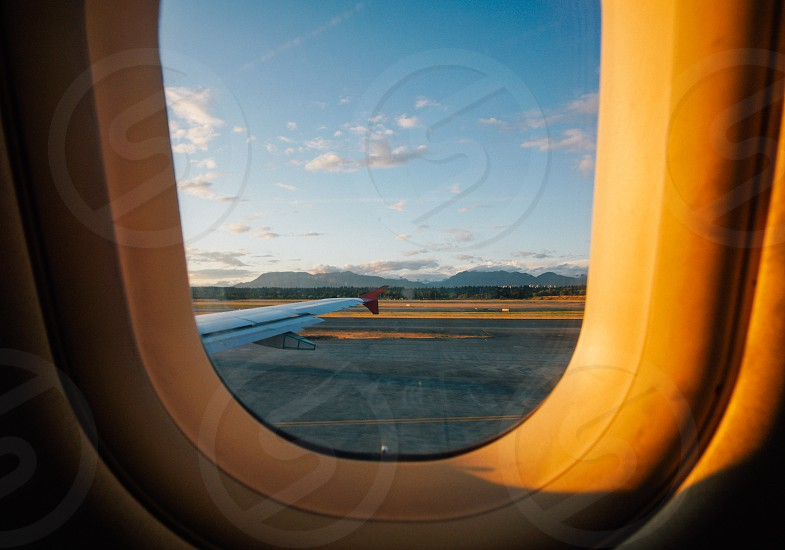 airplane window seat fly sky canada air clouds vancouver travel view wing photo