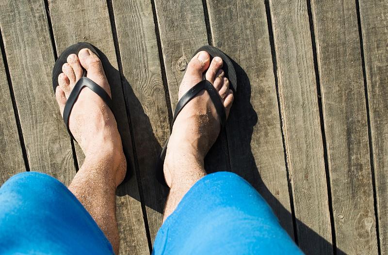 Foot in thongs on the beach Bulgaria photo