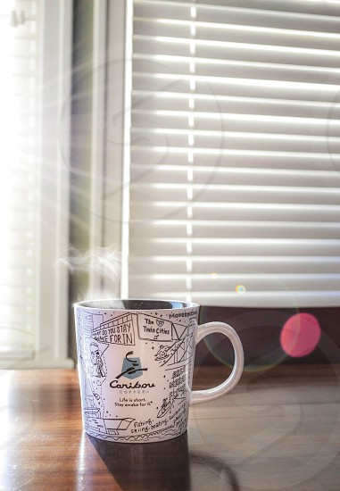 Steaming cup of coffee photo