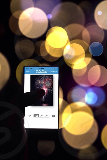 Pokamax app with fireworks reshoot so it says the Pokamax logo photo