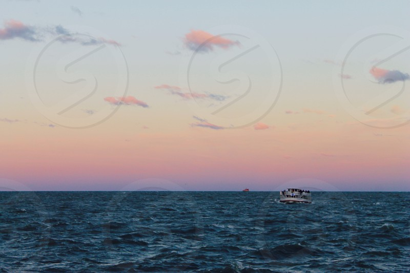 Lonely boat sunset Lake Michigan pink sky blue waters photo