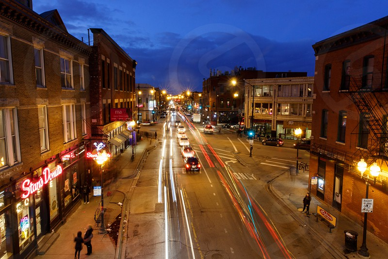 View of the main intersection of Wicker Park from above at night with car lights trailing. photo