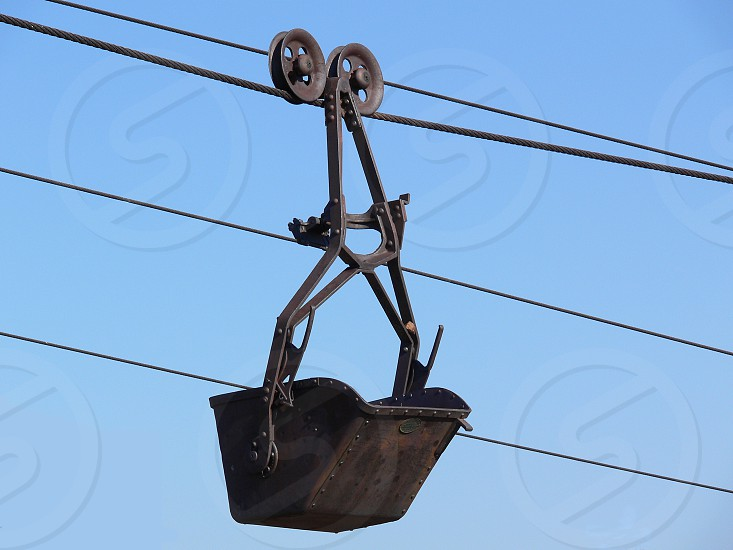 Bucket on a cable for ore mining. photo