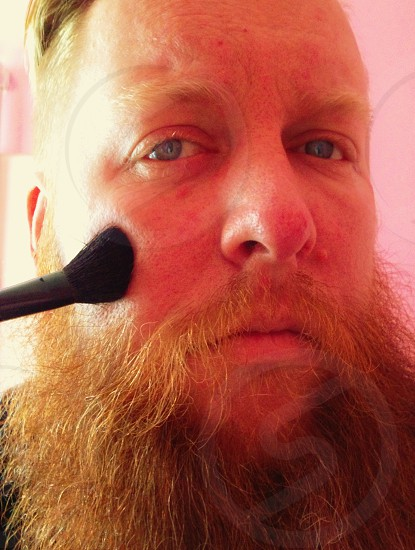 Masculine Man with blush brush  photo