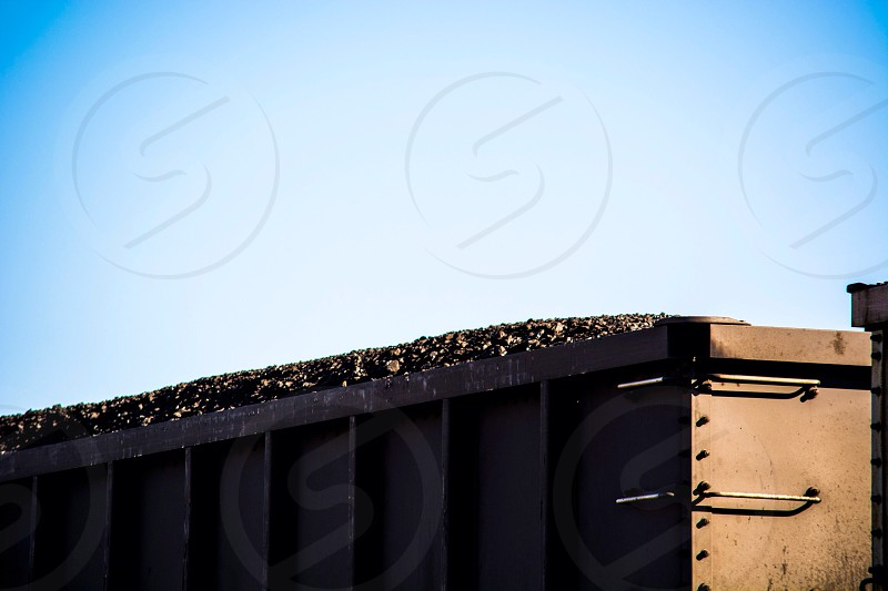 brown steel trash dump container  photo