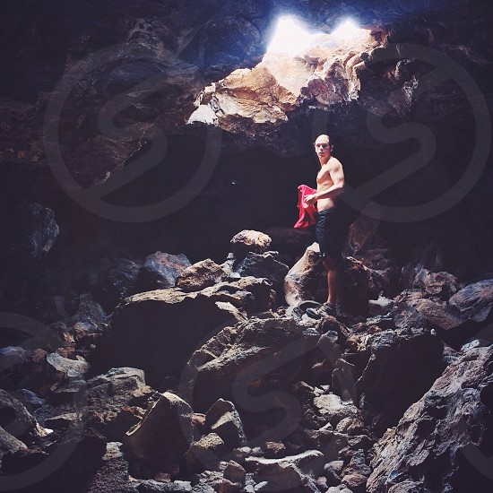 man standing on rocky road photo