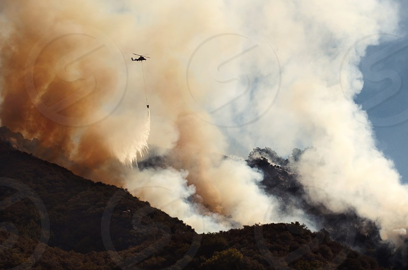 Air units rush to contain the Lookout Fire in Santa Barbara CA USA.  wildfire; fire; california; santa barbara; lookout; 154; san marcos pass; forest fire; brush; smoke; helicopter; environment; drought; rescue photo