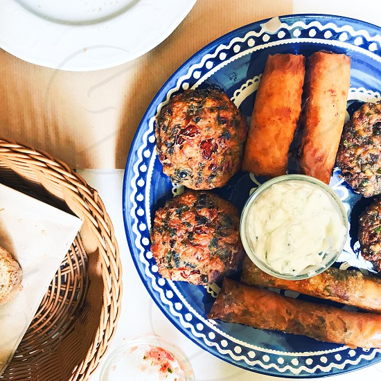 On the table Greek food pies vegetarian  fried vegetables springrolls photo