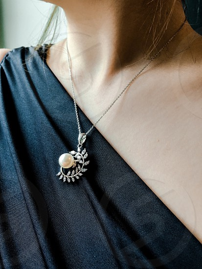 Beautiful women's neck with a brooch on a beautiful dress. From the beauty is always there. Excellent presentation for advertising projects. photo