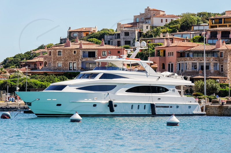 Impressive Motorcruiser Moored in Porto Cervo Harbour photo