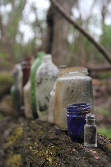 Glass bottles from the 70s found in the woods  photo