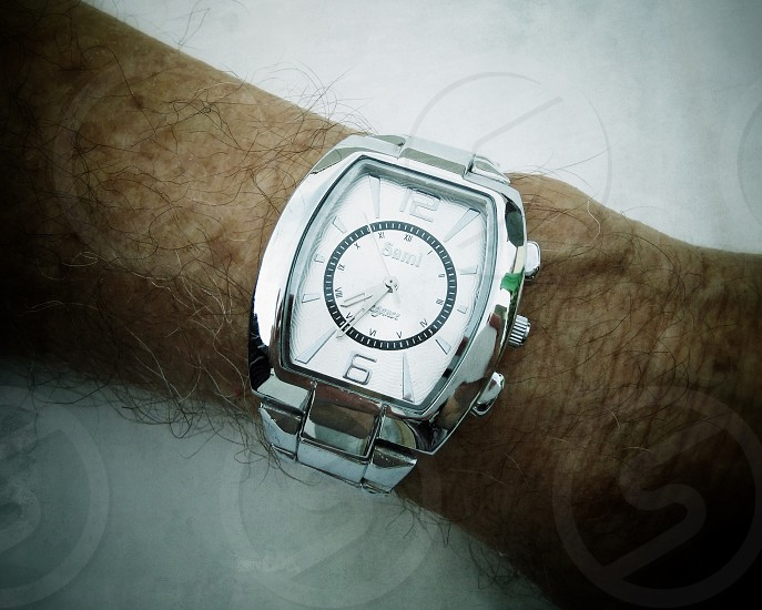 man in silver analog watch photo