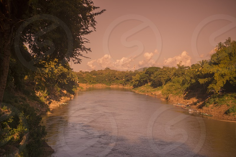the Nam Khan river in the town of Luang Prabang in the north of Laos in Southeastasia. photo