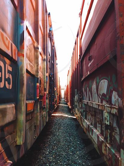 pathway between red walls photo