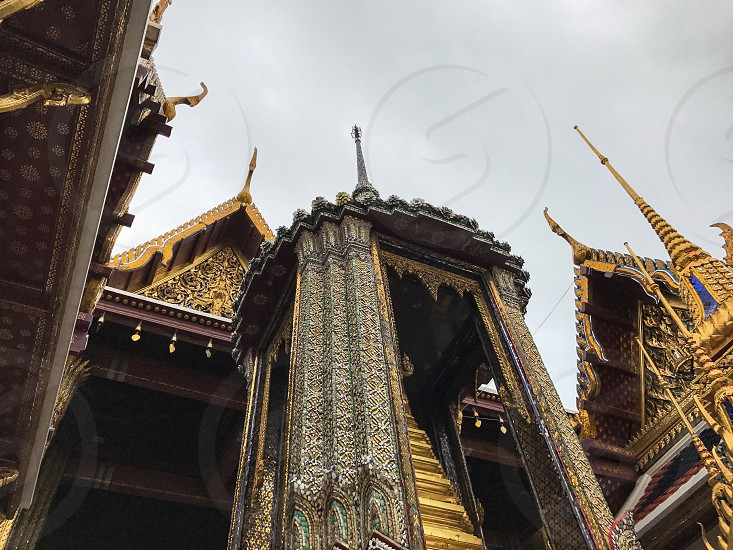 Outdoor day colour vertical portrait Grand Palace Bangkok Thailand Kingdom travel tourism tourist wanderlust gold gold leaf Buddhist Buddhism holy royal regal monarchy temple temples mosaic mirror tile tiles ornate shrine royal regal royalty attraction photo