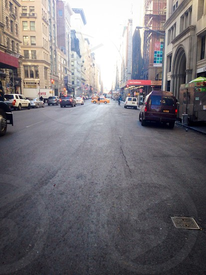 An open road in the middle of it all located Just below the Flatiron Building in Manhattan.  photo