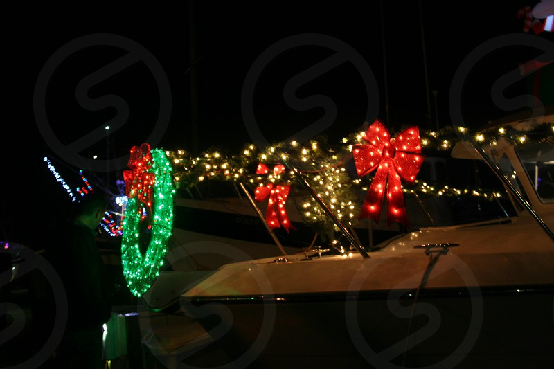Attend Festival of Lights at harbor to see boats decorated for Christmas photo