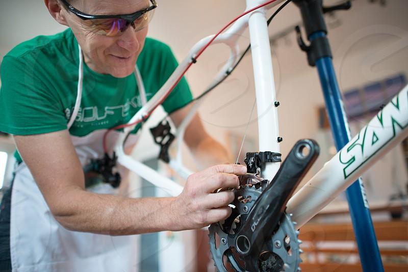 assembling a mountain bike building a mountain bike adjusting the front derailleur. photo