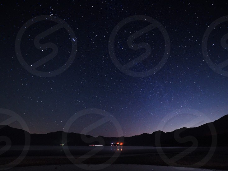 silhouette photography of mountain during nighttime photo