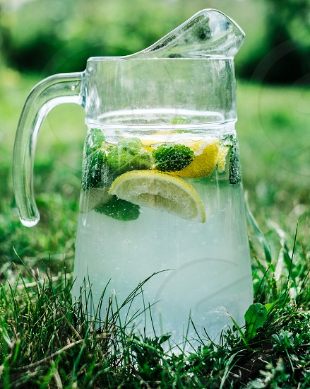 pitcher of mojitos standing on the grass photo