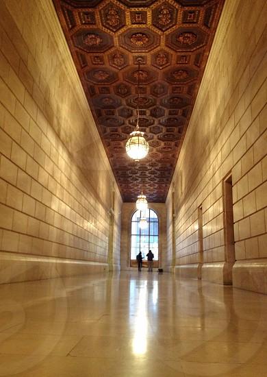 white tiled hall way  photo