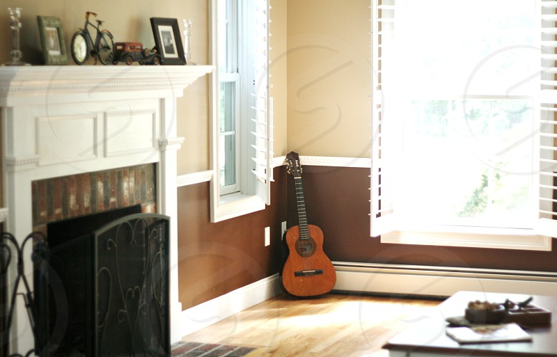 Corner of living room with guitar  home interior. photo