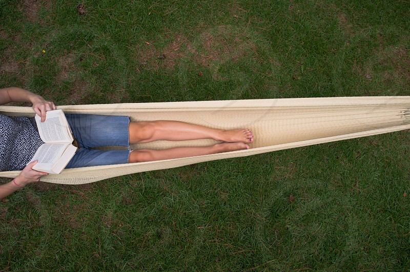 woman sitting on beige hammock photo