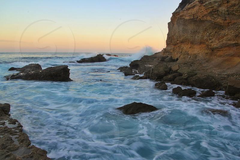 ocean near cliff photo