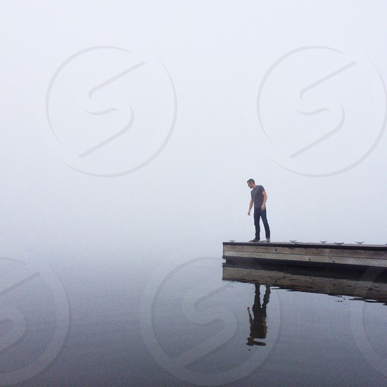 Fog water dock reflection. photo