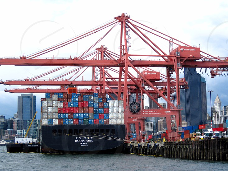 Harboured cargo container loading containers ready for travel around the world photo