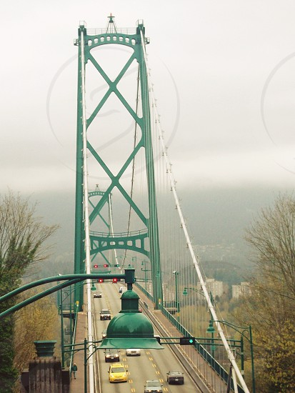 bridge vancouver bc green fog travel cars crossing architecture photo