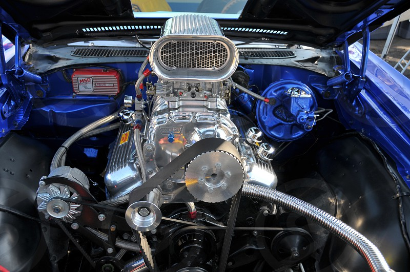 Under the hood of a show car. Engine with blower. photo