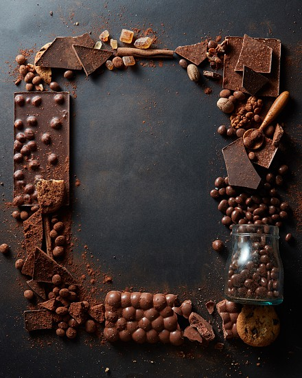 frame of different chocolates on a dark background photo