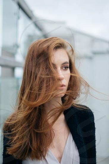 windy portrait of a brunette woman photo