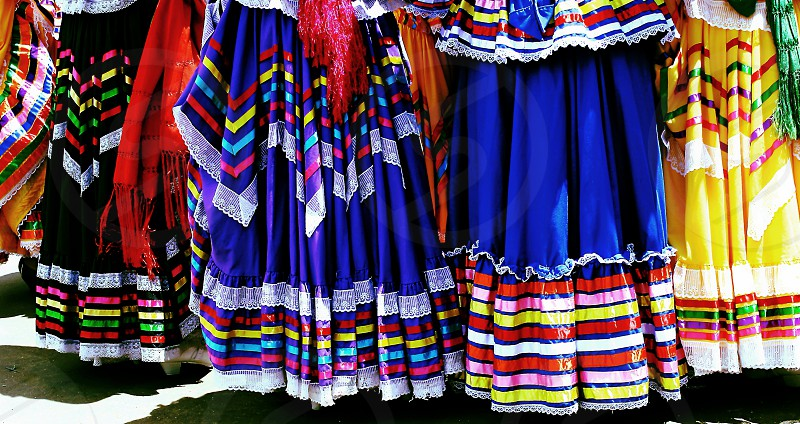 Detail of colorful folkloric skirts photo