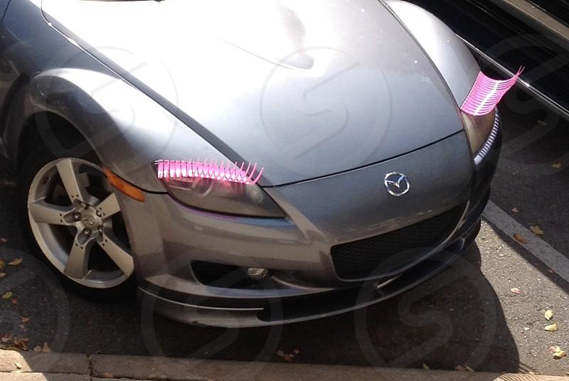Car with plastic pink eyelashes photo