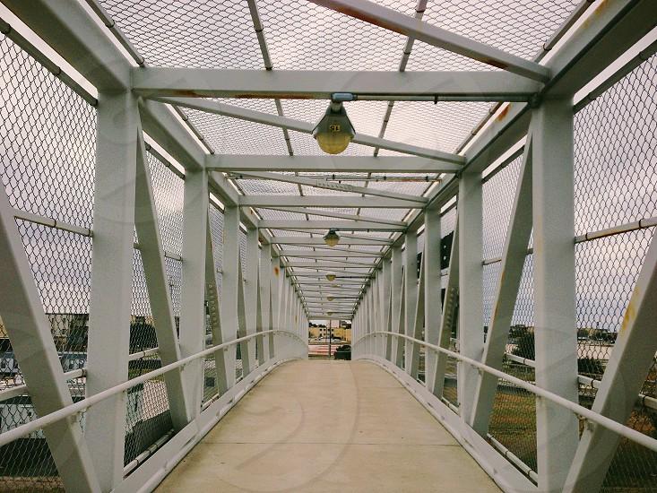 grey metal framed foot bridge  photo
