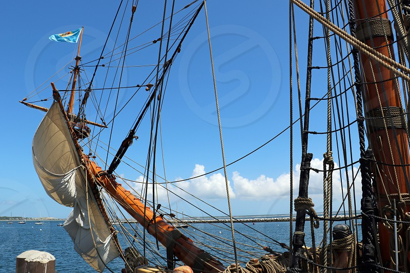 Masts and ropes of a vintage sailing ship are seen photo