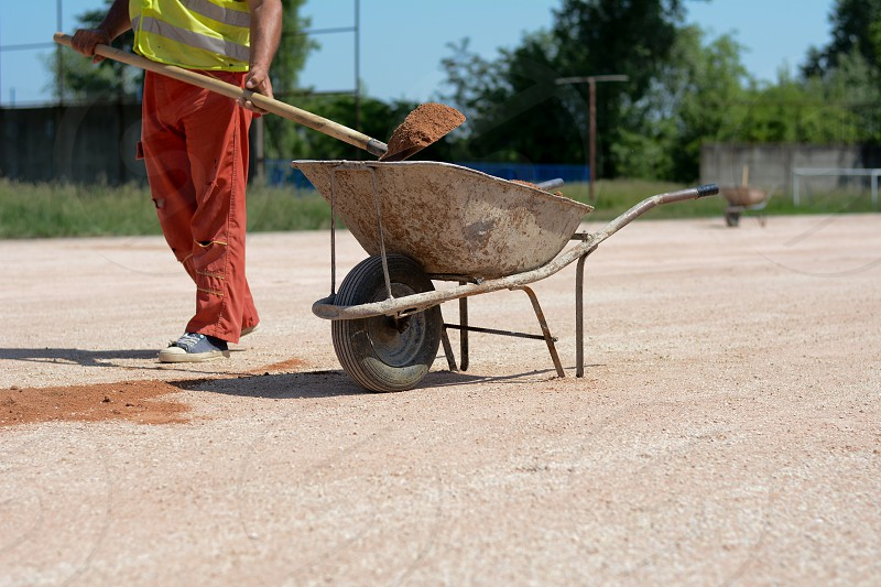 construction worker with a shovel construction site mortar cart sand photo