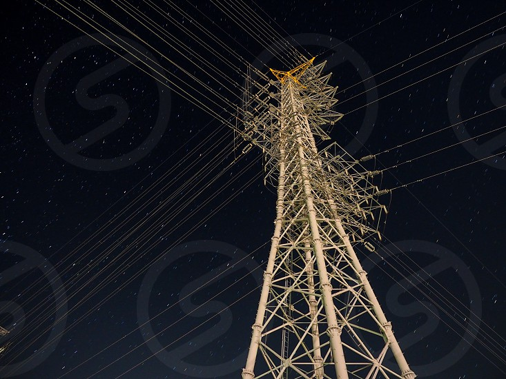 low angle photo of transmission tower during nighttime photo