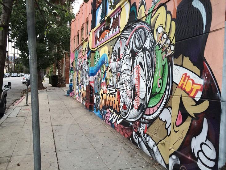 wall mural next to a sidewalk photo