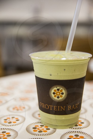 protein bar plastic cup with green drink photo