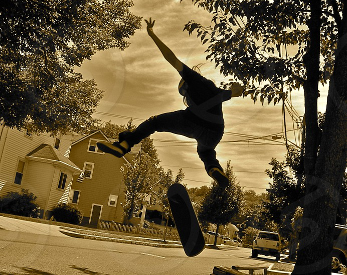 Skateboarders do not just roll down the road they also fly through he air. photo