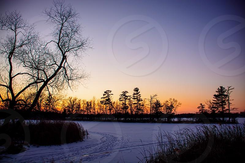 Sunrise over frozen lake  photo