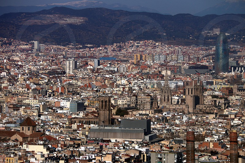 Barcelona city landscape buildings St Eulalia Agbar tower mountains photo