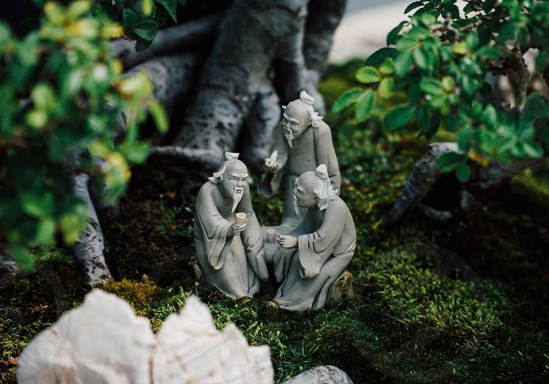 Bonsai clay figures netsuke men statues moss art japanese meeting arrangement photo