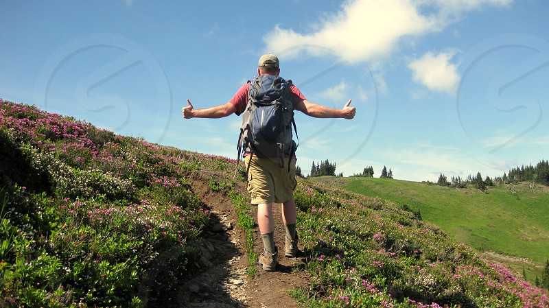 Hiking thumbs-up skyline divide mount baker pnw wildflowers blue sky photo