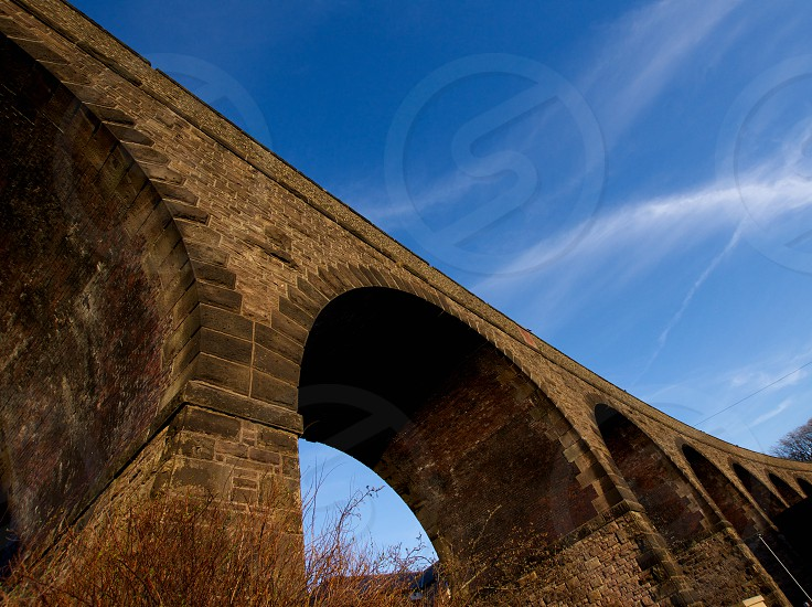 Historic railway stone bridge in BuxtonPeak District National ParkDerbyshireUnited Kingdom. photo